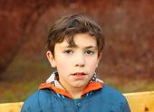 stock photo of preteen  - preteen handsome boy close up portrait in the spring park - JPG