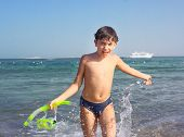 stock photo of preteen  - preteen handsome boy with snorkeling mask and tube on the red sea beach and yaht background - JPG