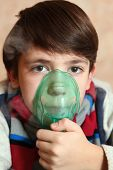 stock photo of inhalant  - boy with electric inhaler as a curation against virul disease flue - JPG