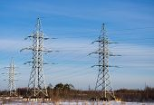 stock photo of power transmission lines  - Power transmission towers against the blue sky - JPG
