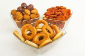 image of bagel  - Bagels cookies and candy apricots in glass cups on a white background - JPG