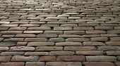 picture of cobblestone  - Part of cobblestone road in the sunset - JPG