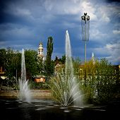 stock photo of fountain grass  - Invigorating coolness of the jet fountain on a hot summer day - JPG