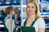 image of dungarees  - Portrait of young female beautiful factory worker - JPG
