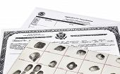 stock photo of deportation  - Certificate of Citizenship fingerprint card and application for naturalization isolated on white - JPG