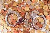 picture of cony  - Picture of a Business Money Concept Idea Conis and Handcuffs - JPG