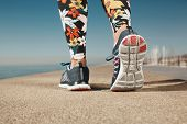pic of jogger  - Runner woman feet running on road closeup on shoe - JPG
