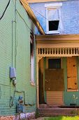 image of house representatives  - Collapsing and abandoned house boarded up representing an economic depression - JPG