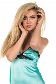stock photo of chemise  - Beautiful tall Russian blonde in a teal chemise - JPG