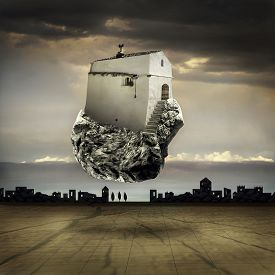 foto of surrealism  - Surreal landscape with a flying house on a rock - JPG