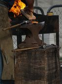 image of clydesdale  - A blacksmiths anvil with a red hot horse shoe on it - JPG