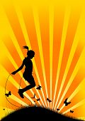 stock photo of jump rope  - girl playing with a skipping rope on the background of the rising sun - JPG