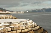pic of gneiss  - Snow covered coastline with air port in the background Molde Norway - JPG