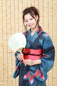 Japanese woman in clothes of kimono