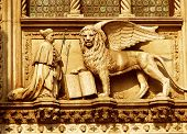 A Winged Lion With A Priest