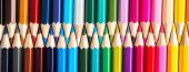 Set Of Colored Pastel Pencils In Row Multi Color In Form Of Closed Zipper And Pencil Sharpener Conce poster