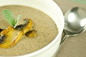 picture of portobello mushroom  - roasted portobello mushroom soup with sage in a white bowl - JPG