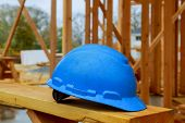 Construction Work Safety Helmets For Professional Builders Are Placed On Wooden Boards.safety Helmet poster