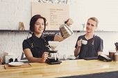 Coffee Business Background With Copy Space. Portrait Of Two Young Bartenders Preparing Fresh Pourove poster