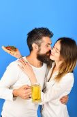 Happy Family Time. Husband And Wife Eating Pizza. Couple Sharing Pizza And Eating Together Happily.  poster