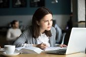 Focused Girl Concerned About Difficult Online Assignment Looking At Laptop Screen Studying Working I poster