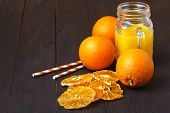 Glass Jar Of Fresh Orange Juice With Fresh Fruits On Wooden Table poster