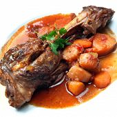 Lamb shank, slow-cooked with root vegetables.  Delicious, hearty eating.