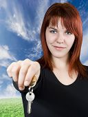 Redhead Girl Passing Keys