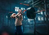 Fit Young Man Lifting Barbells Working Out At A Gym. Sport, Fitness, Weightlifting, Bodybuilding, Tr poster