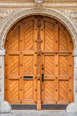 Closeup Of A Beautiful Wooden Door In The Building poster