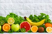 Healthy Food Fruits Grapefruit, Lemon, Kiwi, Apple, Banana, Orange, Green    Salad Background On Whi poster