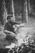 Man With Serious Emotion. Man Traveler Drink Tea At Campfire Flame. Camping, Hiking, Lifestyle. Summ poster