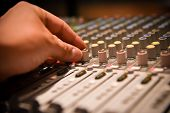 Close-up Hands Of Sound Engineer Adjusting Audio Mixer Controller For Live Music And Studio Equipmen poster