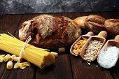 Whole Grain Products With Complex Carbohydrates On Rustic Background poster