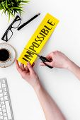 Make The Impossible Possible. Cutting The Part Im Of Written Word Impossible By Sciccors. Office Des poster