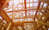 Beam Close-up Building With Under Construction Wooden House With Timber Framing, Truss, Joist poster