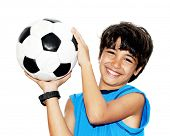Cute boy playing football, happy child, young male teen goalkeeper enjoying sport game, holding ball