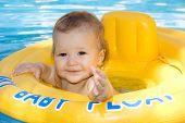 Beautiful Baby Girl Enjoying The Warm Water In The Family Pool