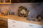 New Years Kitchen Interior, Christmas Wreath Hanging On The Kitchen Wall. New Years Decor Of Kitchen poster