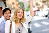image of hail  - Young couple hailing for a taxi cab - JPG