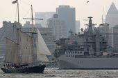 HOBOKEN, NJ - MAY 23: The RFA Argus A135 (UK) passes a tall ship on the Hudson River near Manhattan