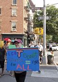 NEW YORK - JUNE 22: Supporters carry signs as they march past Christopher Street and Hudson St on th