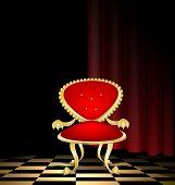 Silla roja en un cuarto oscuro