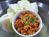 Thai Food Style, Top View Of Spicy Northern Thai Pork With Tomato And Boiled Cabbage In Bowl As A Ba poster