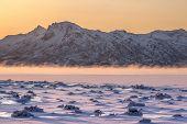 Dramatic Sunrise With Fog Over Lofoten Islands, Norway. Amazing Dramatic Sunset Over Lofoten Islands poster