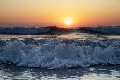 Waves Of The Mediterranean Sea With Sea Foam And Spray. Beautiful Sea On Sunset Background. Sundown. poster