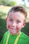 Closeup of a hot and smiling boy at the finish of a marathon or triathlon  poster