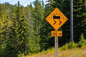 A Close Up View Of A Hazardous Road Condition Sign In Canada, Pavement Is Slippery When Wet, Slow Do poster