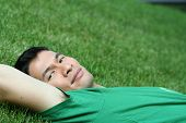 Handsome, Asian Man In Grass