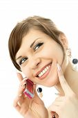foto of chatterbox  - portrait of a happy young beautiful woman talking on the cellphone - JPG